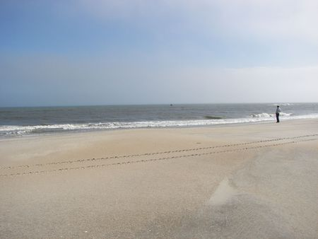 outer banks: Man standing on the beach on the Outer Banks in North Carolina