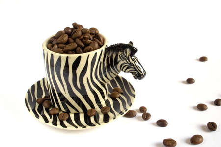simulating: Cup of coffee simulating a zebra with coffee grains in white background