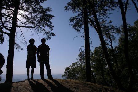 serenety: Couple watching the horizon.