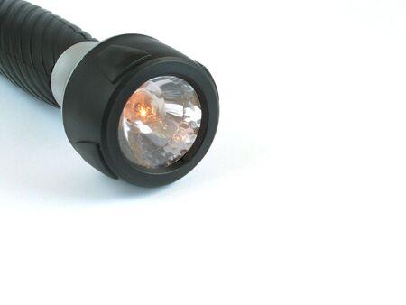 Flashlight in white background photo