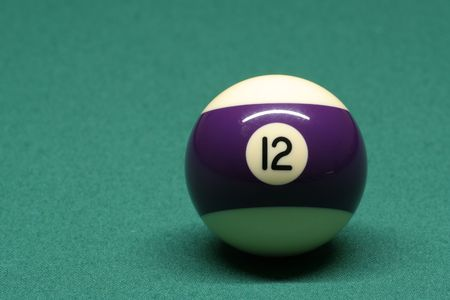 number 12: Pool ball number 12 in pool table Stock Photo