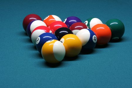 Pool balls in rack position in pool table photo