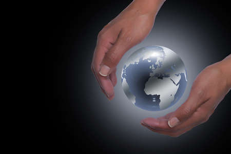 Hands holding planet earth in black background photo