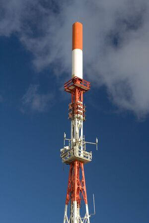 Communication tower with white clouds and blue sky as background Stock Photo - 765199