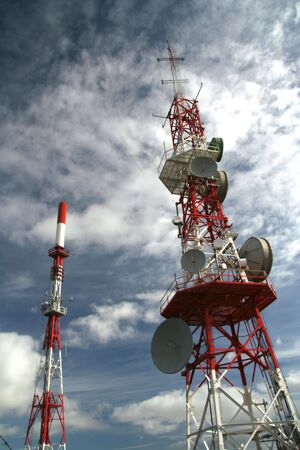 Communication tower with white clouds and blue sky as background Stock Photo - 765198