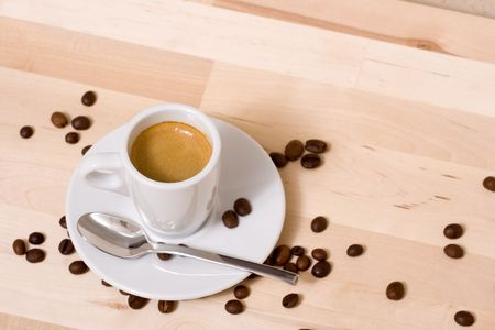 Coffee cup and coffee beans over a wood background Stock Photo - 766241