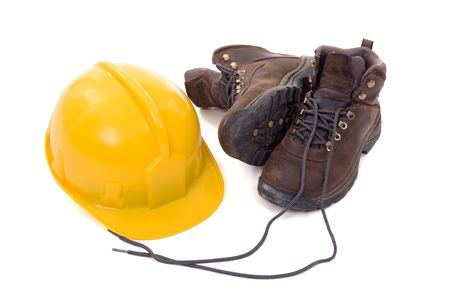 Yellow safety helmet and a pair of boots over white background Stock Photo - 831317