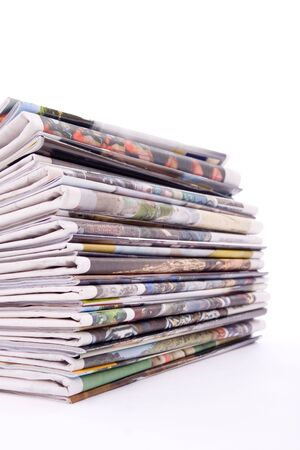 educative: Pile of newspapers and magazines to recycle over white background.
