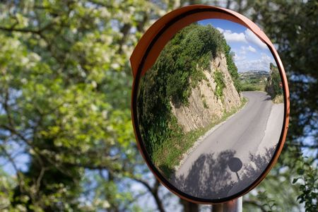 Defensive driving mirror with landscape reflected on it