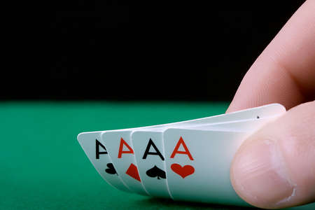 Player�s hand revealing Four Aces