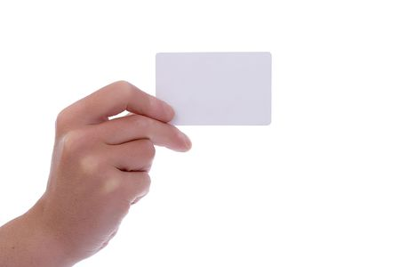 Hand holding a business card with copy space over white background. Stock Photo