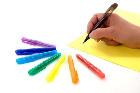 Hand of a woman writing on a sheet of paper with different colour pens at her disposable Stock Photo - 926460