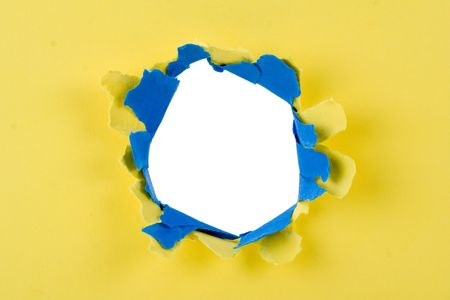 boring frame: Big hole in a blue and yellow cardboard
