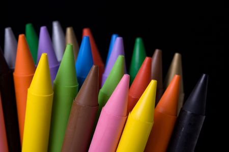 Close up of crayons with different colors over black background. Shallow depth of field. Stock Photo - 974115
