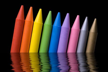 Close up of crayons with different colors over black background and water reflex Stock Photo - 974116
