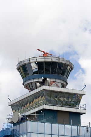 Airport control tower over cloudy blue sky photo