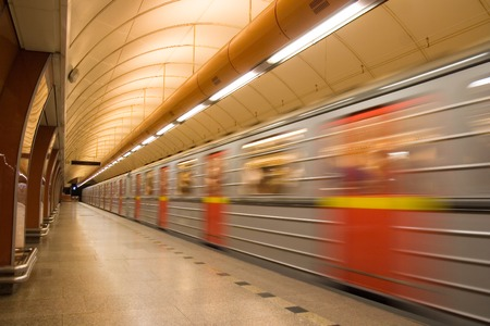 Subway station platform with train passing by Stock Photo