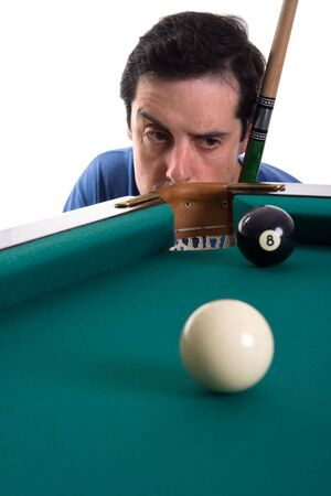 Pool player looking suspiciously to eight ball near corner pocket photo