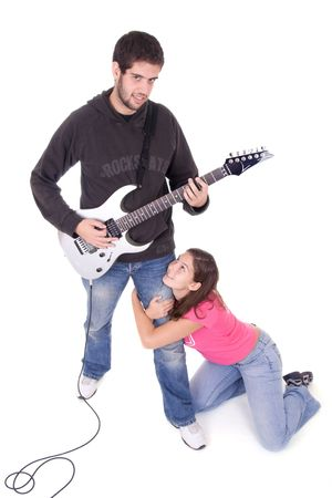 Young electric guitar player with beautiful young girl grabbing his leg photo
