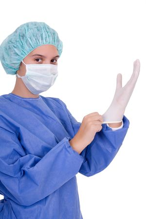 Young female doctor putting on surgical gloves Stock Photo - 1907117