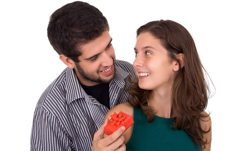 Young couple. Man giving a present to a beautiful young woman. photo