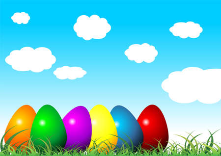 Easter eggs on grass with different colors over cloudy blue sky Stock Photo - 2661907