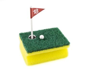 eighteen: Eighteen hole on a scrub sponge over white