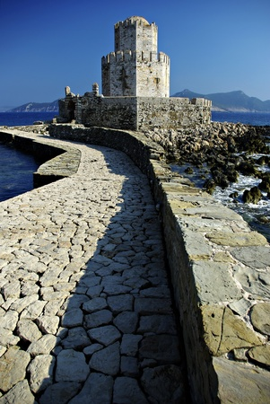 A stone-paved stretch leads over a small bridge to the small fortified islet of Bourtzi and spectacular sea gate.