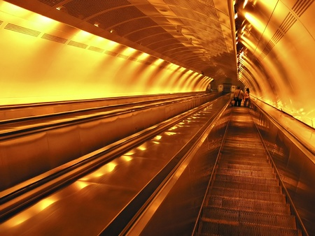Escalator to subway station under neon lights. Stock Photo