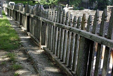 Old traditional rural wooden fence at local village.