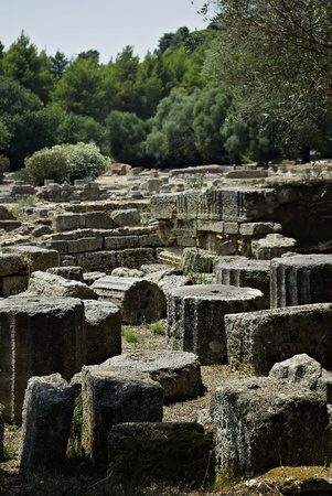 Old stone columns in open museum at Olympia, Greece at sunny summer day  photo