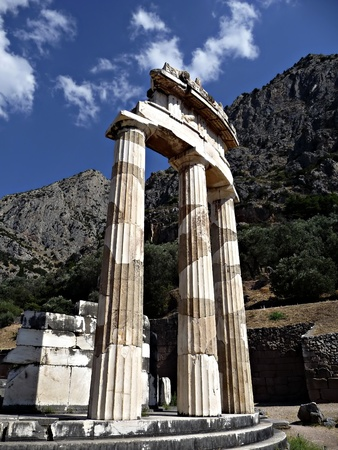 Ruins of Athena temple at Delphy at sunny summer day.