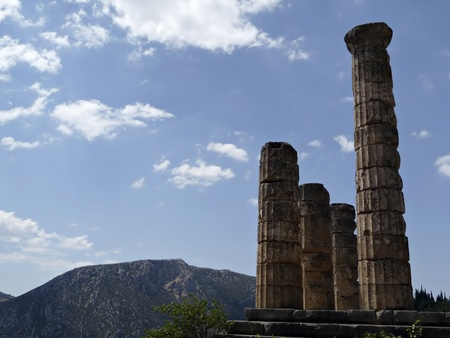 Ruins of Apollo temple at Delphy at sunny smmer day agains blue sky. Stock Photo