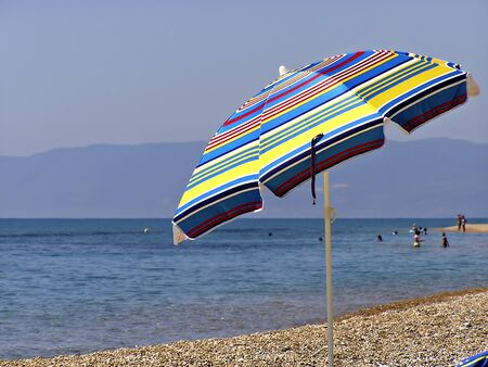 Colorfull beach umbrella at sunny summer day