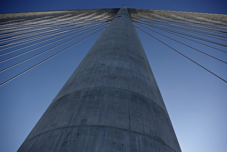 Suspension cables at modern highway bridge against clear blue sky at sunny summer day over river Sava at Balgrade, Serbia
