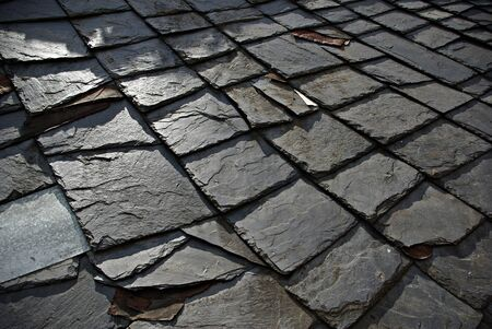 Ancient roof made of stone plates on old country house