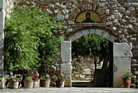 Entrance to the church at old Greek monastery of Agios Loukas at sunny summer day