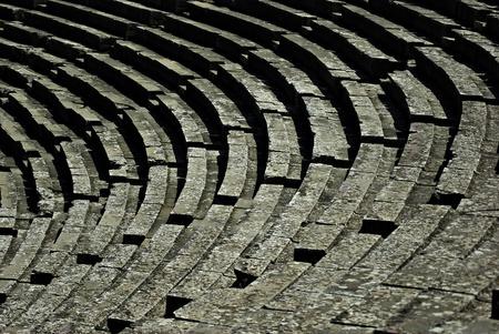 Detail of seats at ancient Greek amphitheater of Epidaurus at sunny summer day  photo