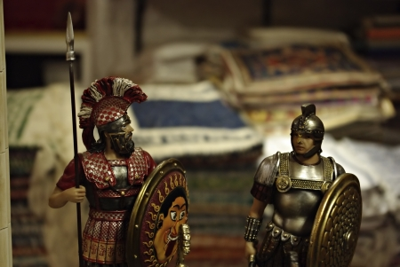 Shelf in antiquities shop with metal medieval crusades knight soldiers  photo