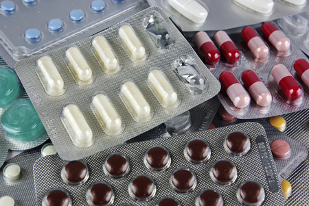 Pills, medicals, drugs, tablets in different colors, packed. Stock Photo