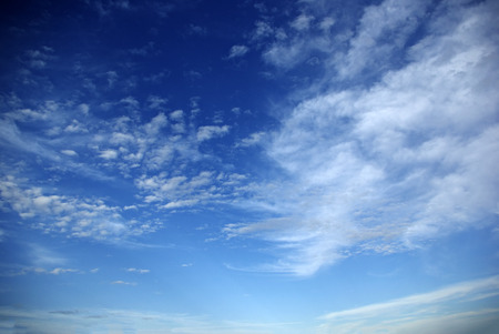 Late afternoon deep blue sky with clouds, white to deep grey. Stock Photo
