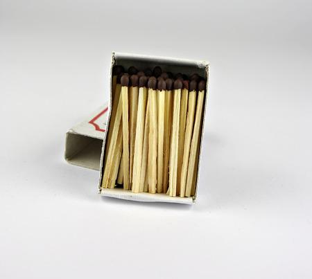 Open matchbox with wooden match sticks. photo