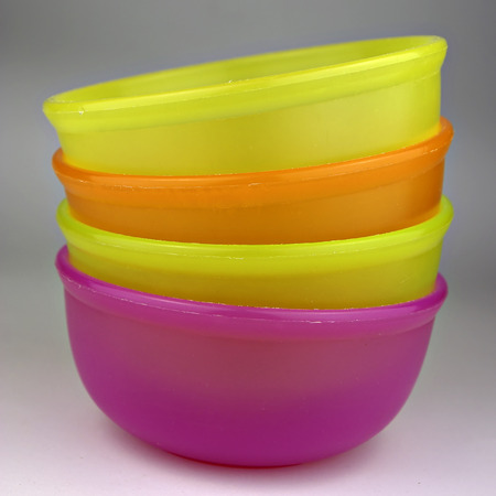Colorful plastic bowls, stacked and ready for use.