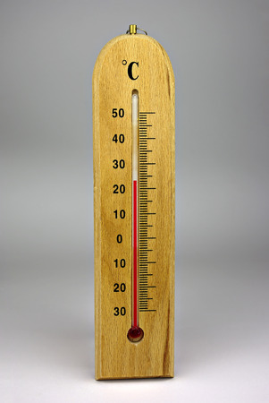 External thermometer on wooden plate with celsius grade. Stock Photo