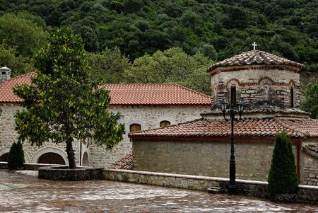 Giromeri monastery hidden in deep woods at sunny summer day.