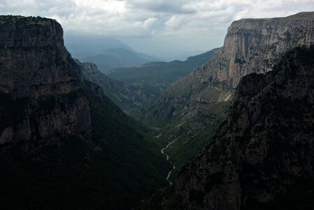 The Vikos Gorge is a gorge in the Pindus Mountains of northern Greece. It lies on the southern slopes of Mount Tymfi, with a length of about 20 km, depth ranging from 120 to 490 m, and a width ranging from 400 m to only a few meters at its narrowest part. Vikos is listed as the world's