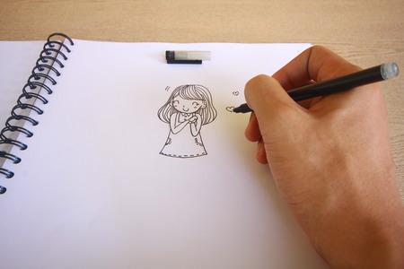 Cartoon tekening notitieboekje op houten bureau achtergrond.