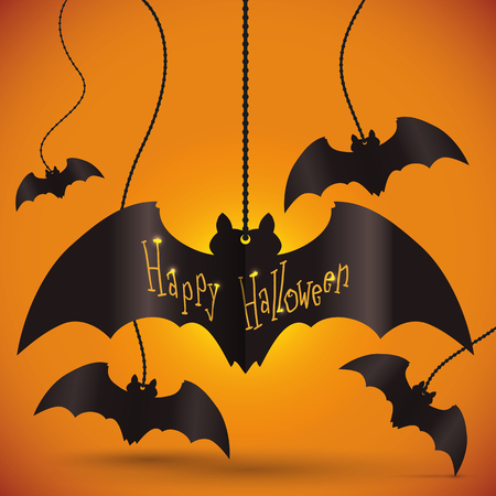 key chain: Happy Halloween bats key chain hanging on the wall over orange background