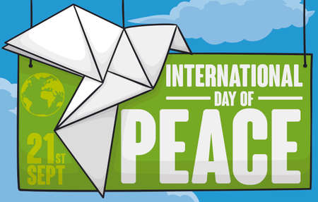 Banner with green sign and white origami dove hanged with view of a calm sky with clouds to celebrate International Day of Peace in September 21.