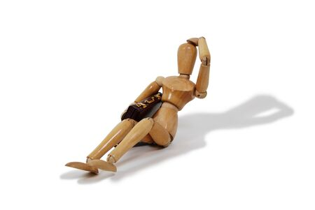 Wooden model representing a person laying on the ground with leather Briefcase Stock Photo - 3953703